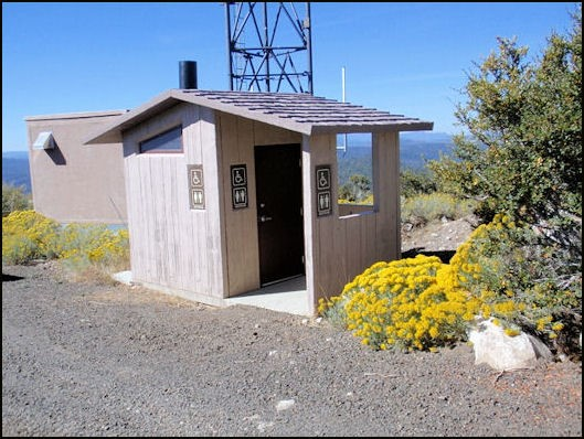 Vault toilet building near lookout